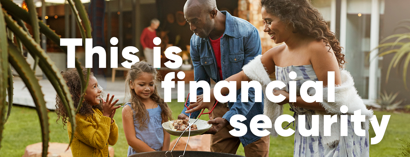 This is financial security; photo of a family smiling at each other around a barbeque.